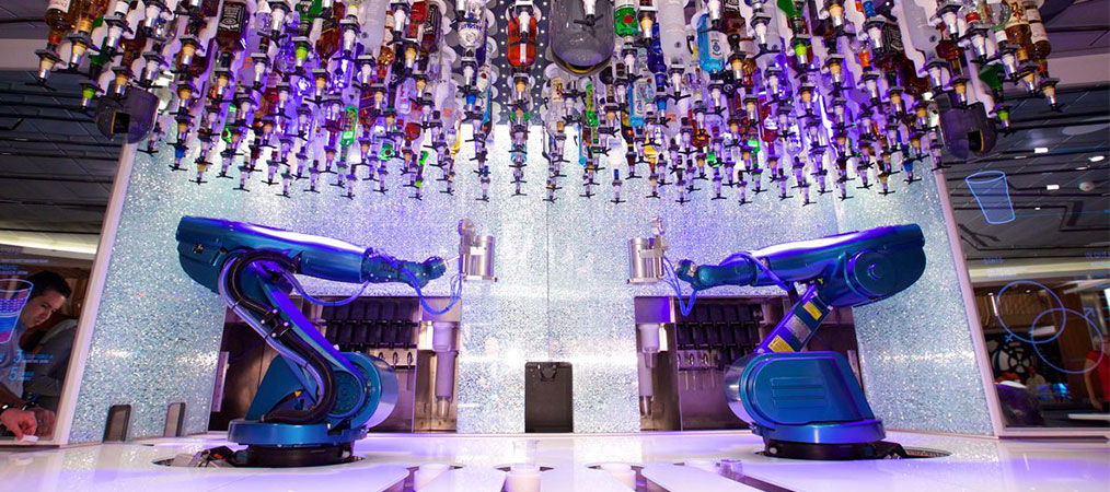 Two robotic arms making drinks at the Bionic Bar on Harmony of the Seas