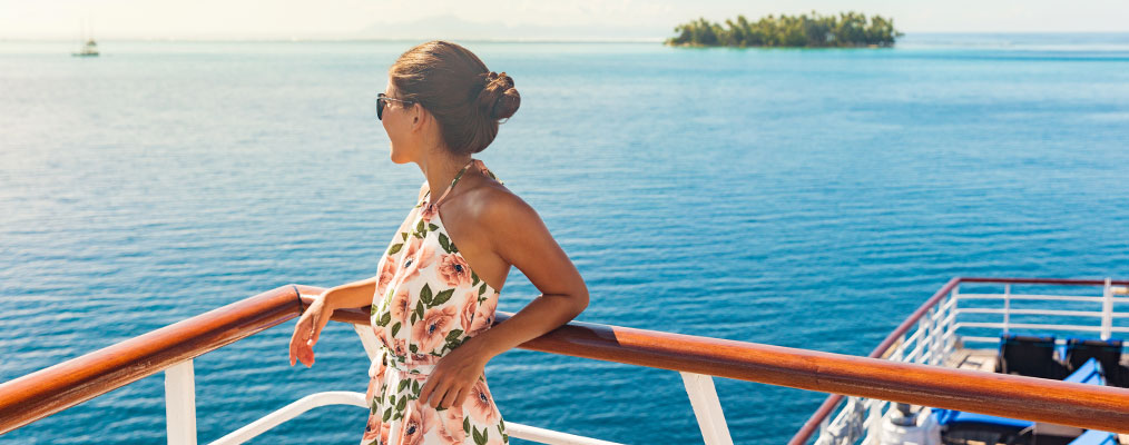 Woman on cruise looking out to sea