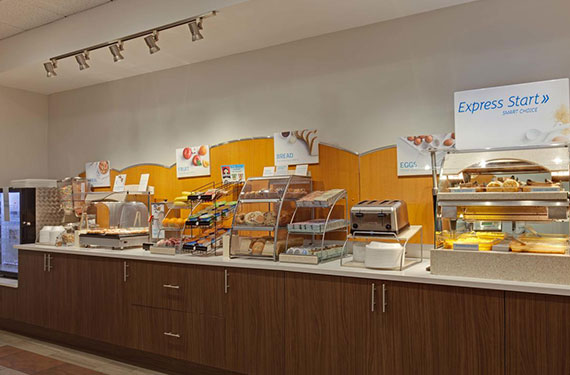 complimentary buffet breakfast serving area at Holiday Inn Express Orlando Airport hotel'