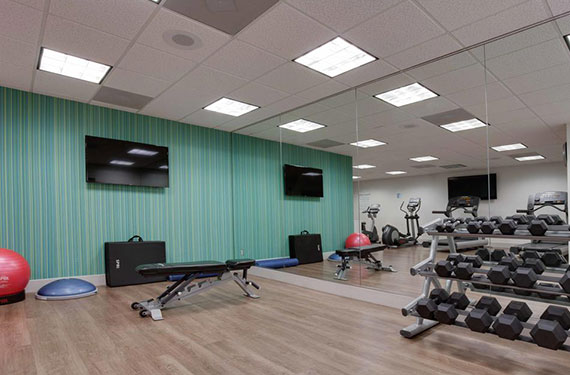 weights and equipment in Holiday Inn Express Orlando Airport fitness center'