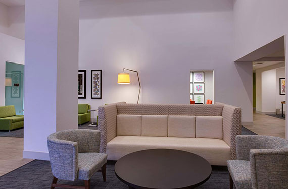 couches and chairs in lobby of Holiday Inn Express Orlando Airport hotel