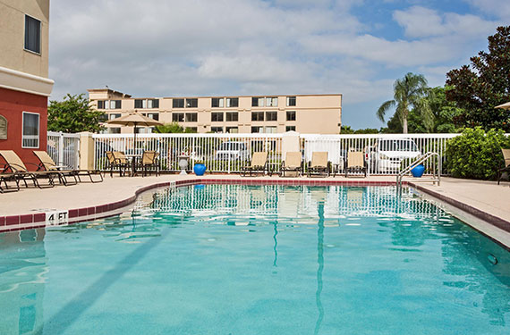 outdoor pool and lounge chairs at Holiday Inn Express Orlando Airport'