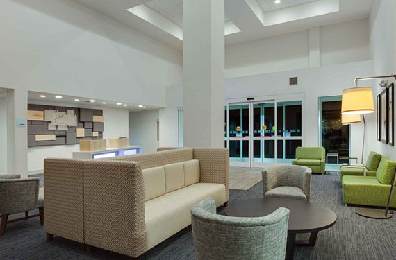 seating area in lobby of Holiday Inn Express Orlando Airport hotel 