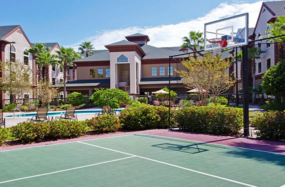 exterior view of Staybridge Suites Orlando Airport and sports courts'
