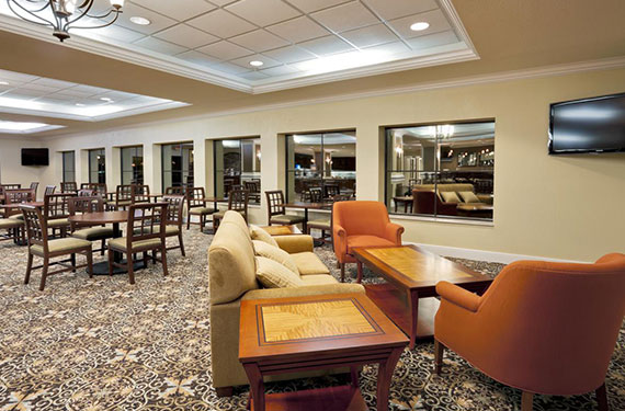 tables and chairs in dining area at Staybridge Suites Orlando Airport hotel'