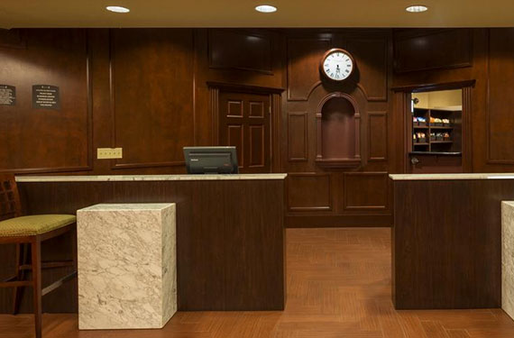 front desk in lobby of Staybridge Suites Orlando Airport hotel'