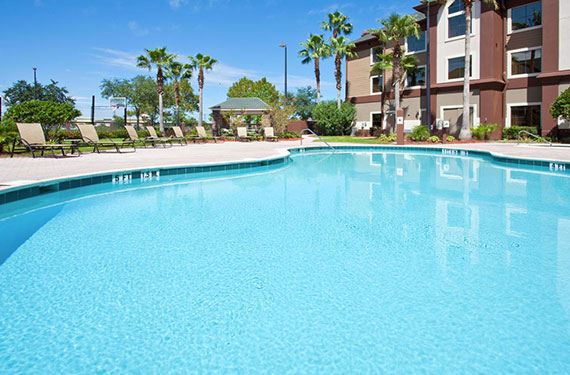 outdoor pool and lounge chairs at Staybridge Suites Orlando Airport hotel '