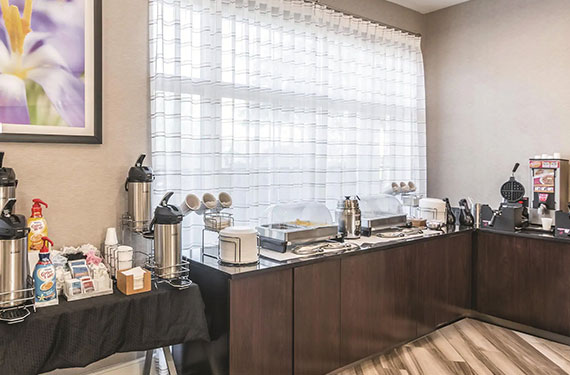 coffee station and waffle makers at complimentary self-serve breakfast buffet at La Quinta Inn Airport North hotel '