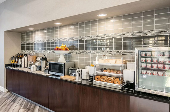 baked goods and refrigerated yogurts as part of La Quinta Inn Airport North hotel's complimentary self-serve breakfast buffet '