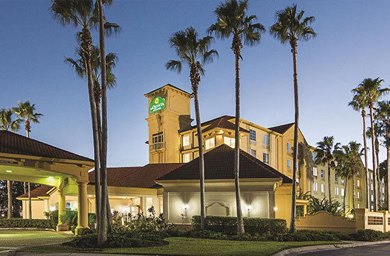exterior view of La Quinta Inn Airport North hotel and lobby in the evening '