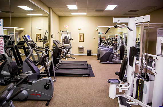 fully equipped fitness center at Ocean Landings Cocoa Beach hotel'