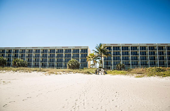 exterior oceanfront view of Ocean Landings Cocoa Beach hotel'