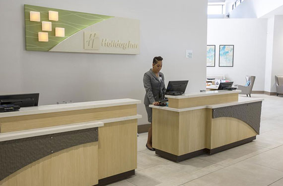 front desk in lobby of Holiday Inn Orlando Airport hotel