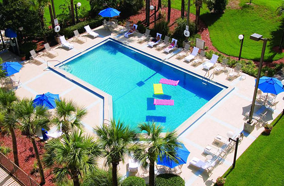 aerial view of outdoor pool and lounge chairs at Holiday Inn Orlando Airport hotel'