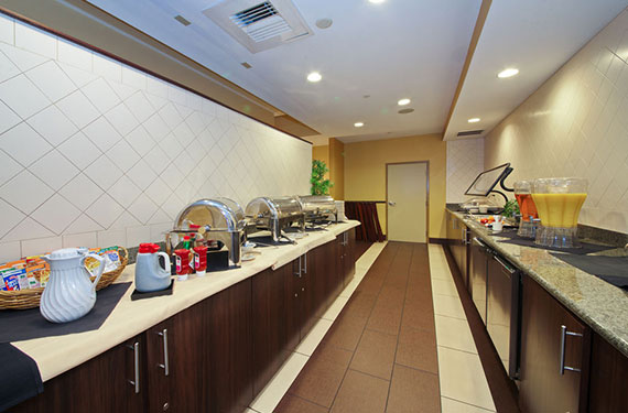 onsite breakfast serving area at Holiday Inn Titusville Kennedy Space Center