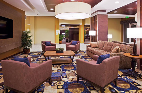 couches, chairs, and coffee table Holiday Inn Titusville Kennedy Space Center hotel lobby