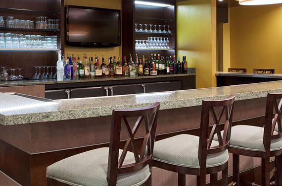 bar and bar stools at Holiday Inn Titusville Kennedy Space Center hotel