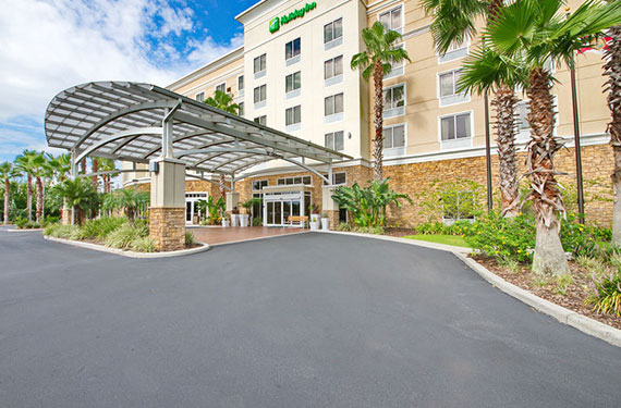 exterior view of Holiday Inn Titusville Kennedy Space Center hotel and lobby entrance