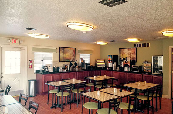 complimentary breakfast buffet self-serve counter and dining area at Best Western Titusville