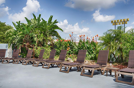 poolside lounge chairs at Best Western Titusville's outdoor pool