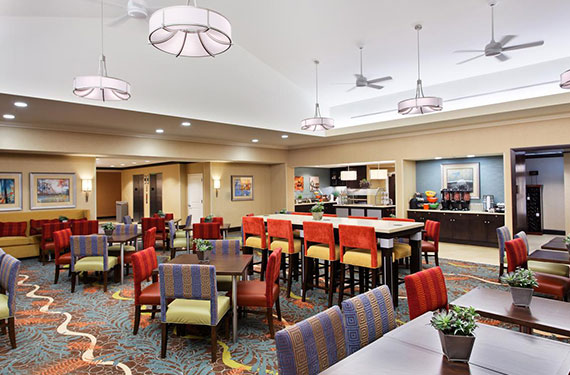 dining tables and chairs for breakfast buffet at Homewood Suites Orlando Airport Gateway Village hotel