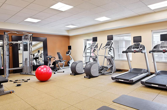 fully equipped fitness center at Homewood Suites Orlando Airport Gateway Village hotel