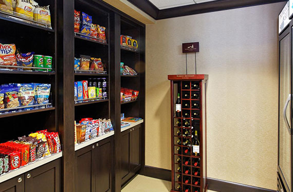 assortment of snacks and wine at Homewood Suites Orlando Airport Gateway Village market