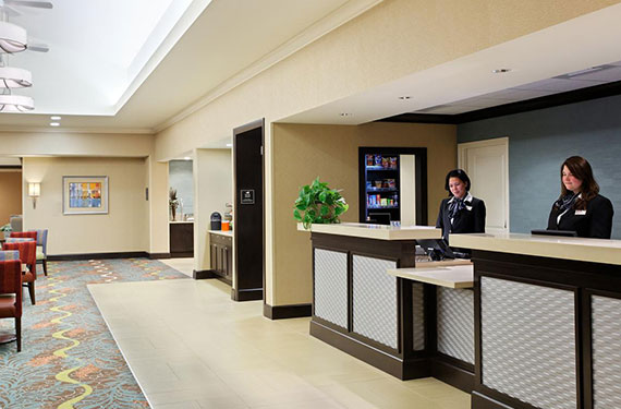 front desk and in lobby of Homewood Suites Orlando Airport Gateway Village