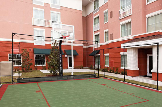 basketball court outside of Homewood Suites Orlando Airport Gateway Village hotel