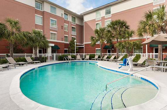 outdoor pool and lounge chairs at Homewood Suites Orlando Airport Gateway Village