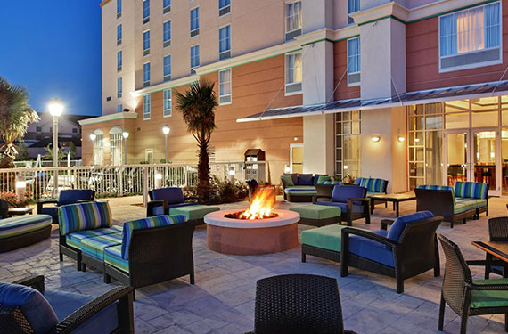 outdoor fire pit and seating outside of Hampton Inn Orlando Airport Gateway Village hotel