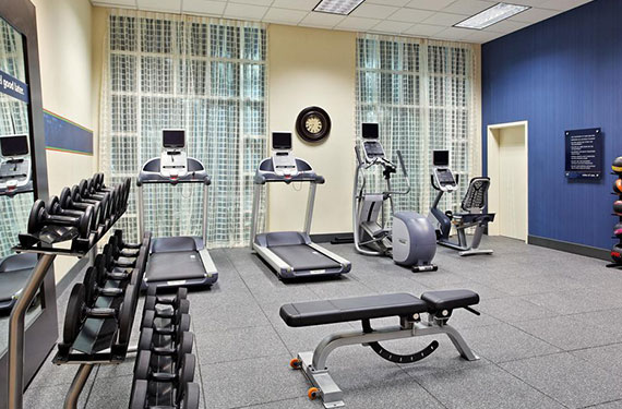 treadmills, weights, and other gym equipment at Hampton Inn Orlando Airport Gateway Village hotel