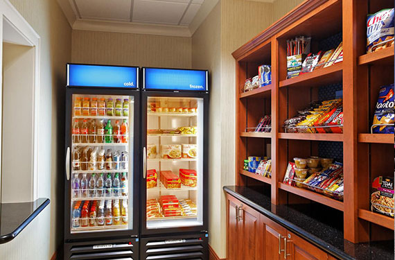 assortment of refrigerated beverages and packaged snacks at Hampton Inn Orlando Airport Gateway Village hotel market
