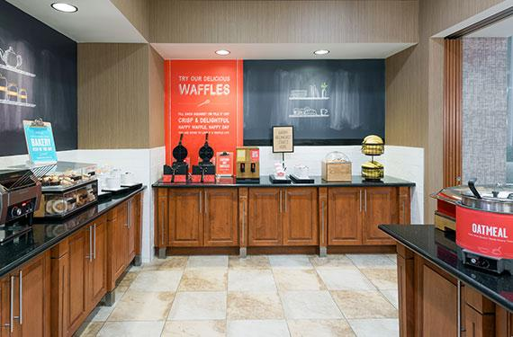 view of complimentary buffet breakfast serving area at Hampton Inn Orlando Airport Gateway Village