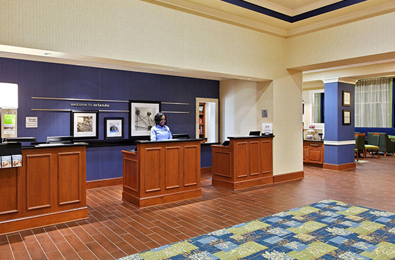front desk in lobby of Hampton Inn Orlando Airport Gateway Village hotel