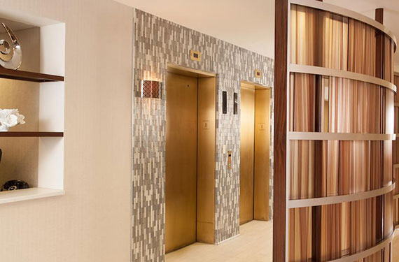 2 elevators at Hampton Inn Orlando Airport hotel lobby
