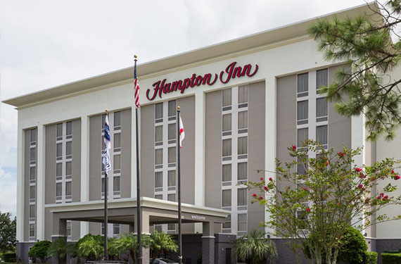 exterior view of Hampton Inn Orlando Airport hotel and lobby entrance'