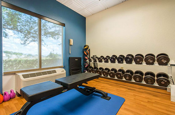 fitness center at Comfort Inn & Suites Sanford with weights and bench'