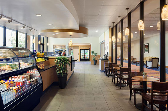 The Coffee Bean & Tea Leaf counter and dining area at Marriott Lakeside Orlando Airport serving coffee, baked goods, snacks and a variety of grab-and-go lunch items'