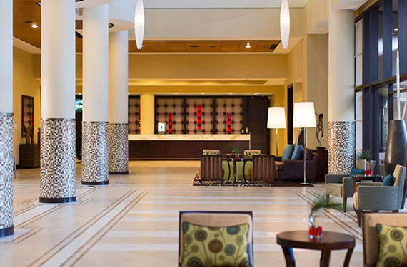 lobby entrance, seating, pillars, and check in desk at Marriott Lakeside Orlando Airport hotel