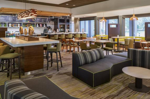 Bistro restaurant at Courtyard Marriott Orlando Airport with tables and seating'