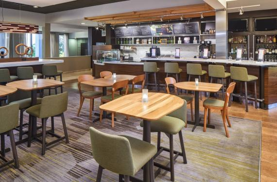 Bistro restaurant at Courtyard Marriott Orlando Airport with service counter and seating'