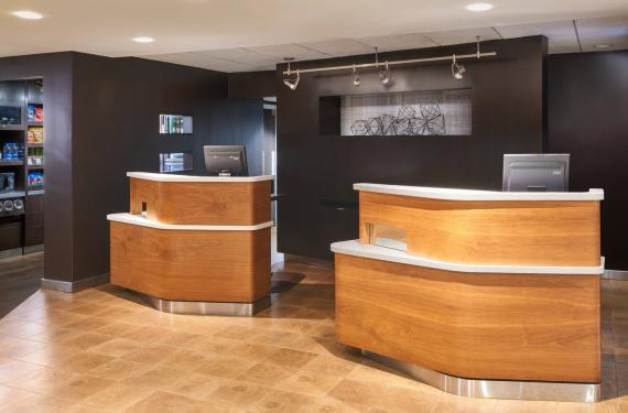 front desk in lobby of Courtyard Marriott Orlando Airport hotel'