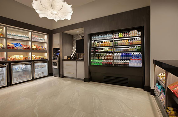 snacks, beverages, and other refreshments at Embassy Suites Orlando Airport hotel onsite market'