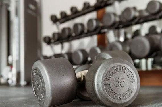 weights and gym equipment at Hampton Inn Cape Canaveral hotel fitness center '