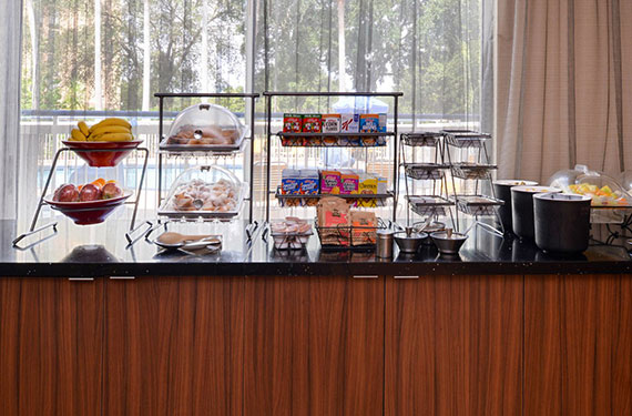 assortment of fruit, baked goods, cereal, and fruit at complimentary buffet breakfast buffet at Fairfield Inn Orlando Airport hotel