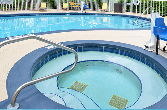 hot tub and pool at Fairfield Inn Orlando Airport hotel'