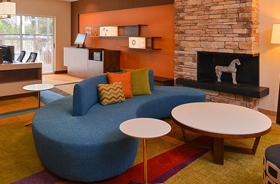 seating and coffee tables in lobby of Fairfield Inn Orlando Airport hotel '